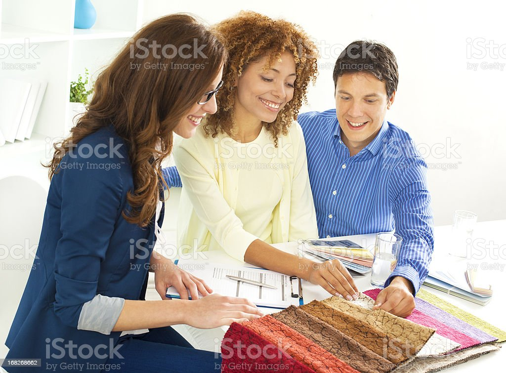 Couple Meeting with Interior Designer stock photo
