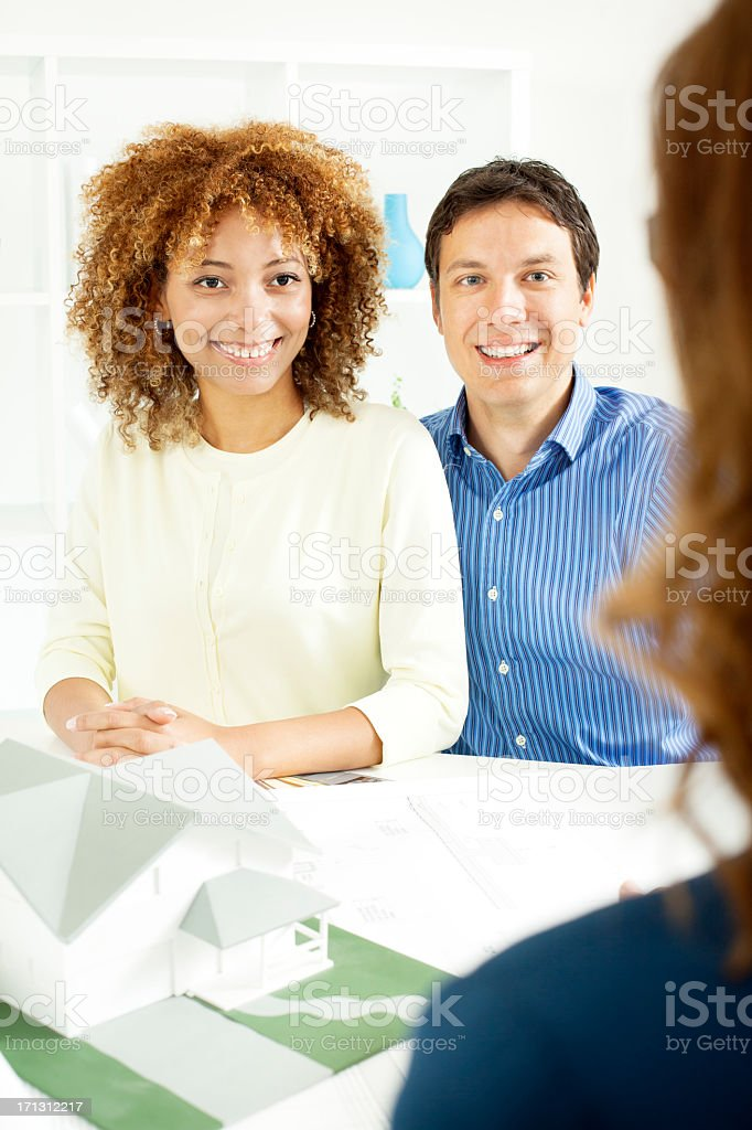 Couple Meeting with Real Estate Agent. royalty-free stock photo