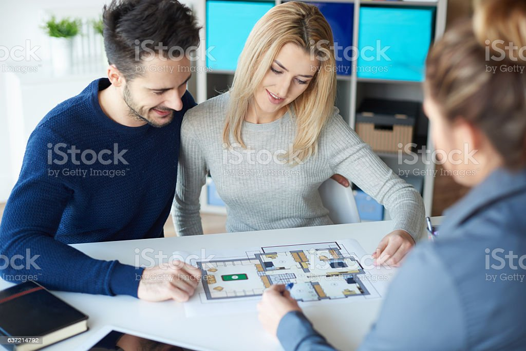 Couple meeting with real estate agent stock photo