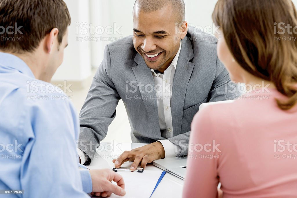 Couple meeting with their financial advisor. stock photo