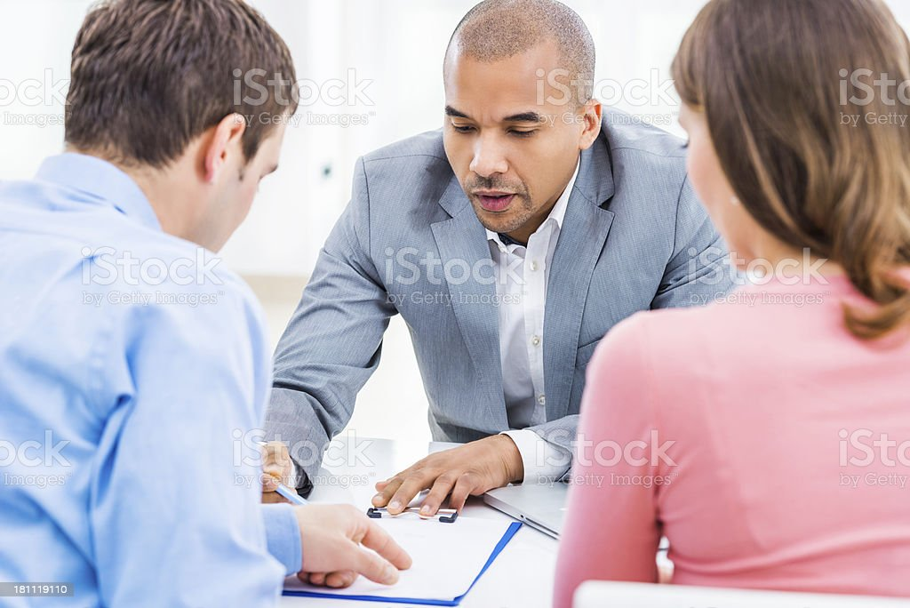 Couple meeting with their financial advisor. royalty-free stock photo