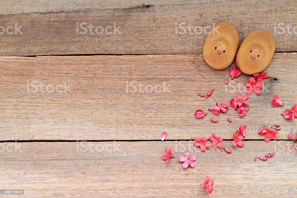 Couple mochi and red flowers on wooden background stock photo