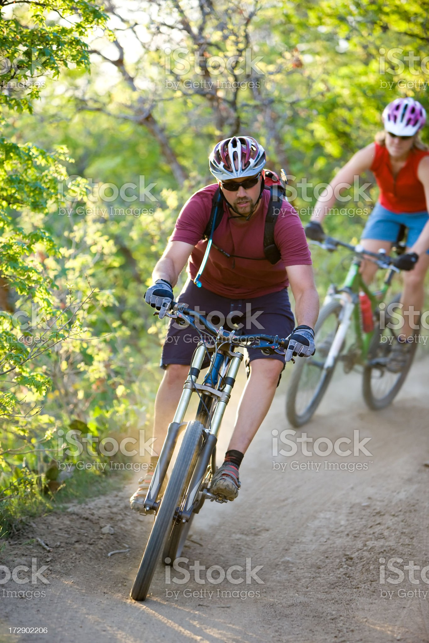 Couple Mountain Biking at Dusk royalty-free stock photo