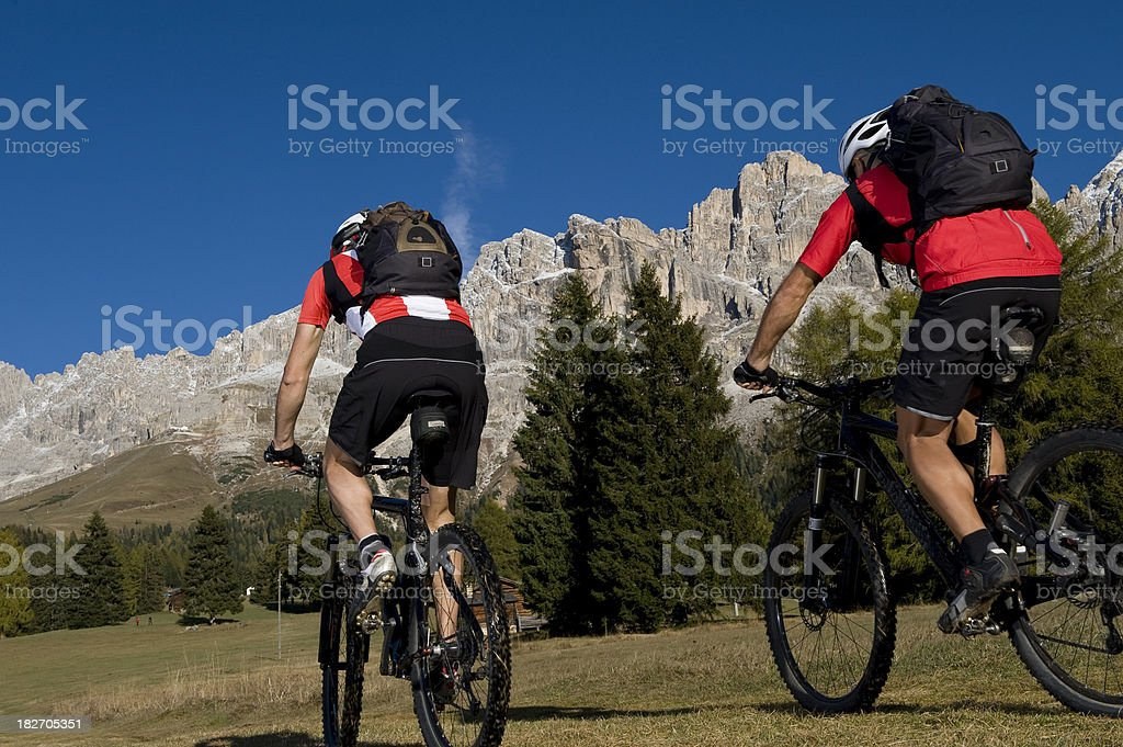 Couple Mountain Biking royalty-free stock photo