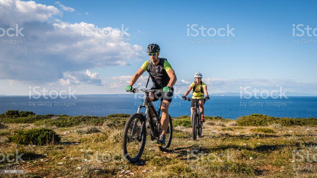 Couple mountain biking stock photo