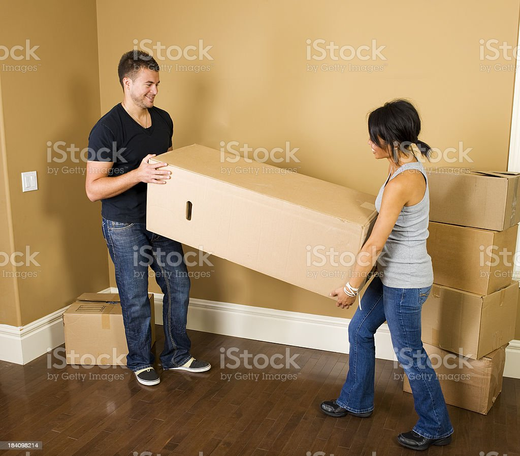 Couple moving boxes royalty-free stock photo