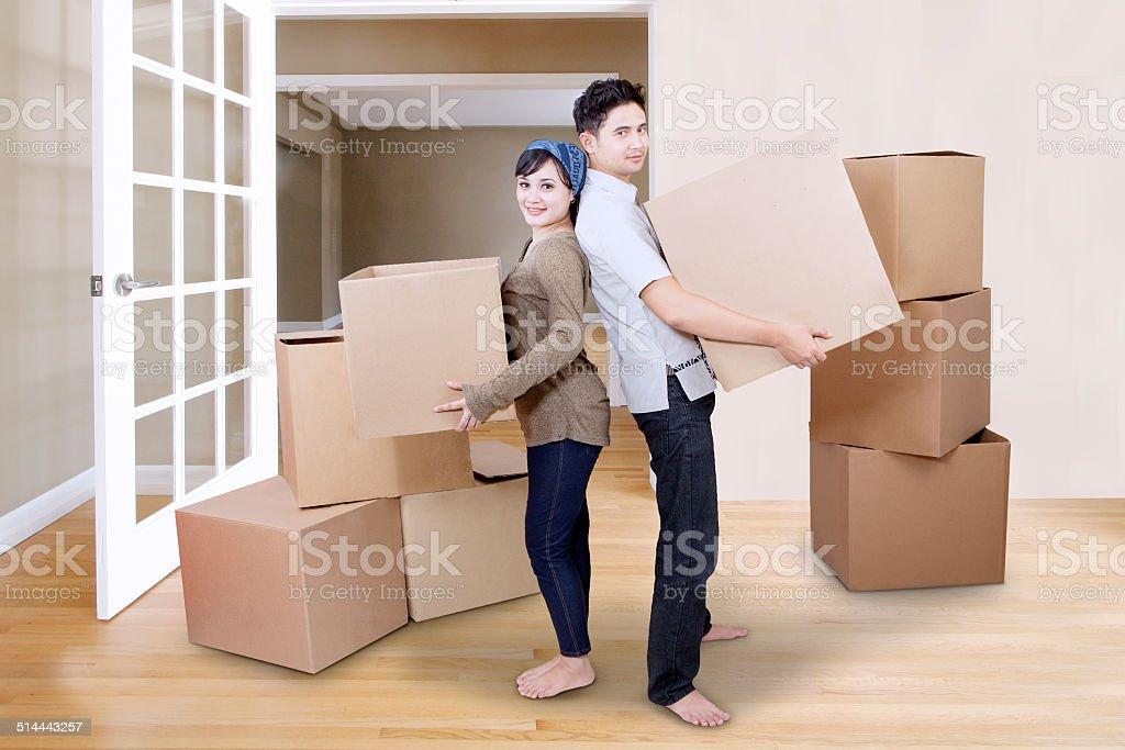 Couple moving boxes stock photo