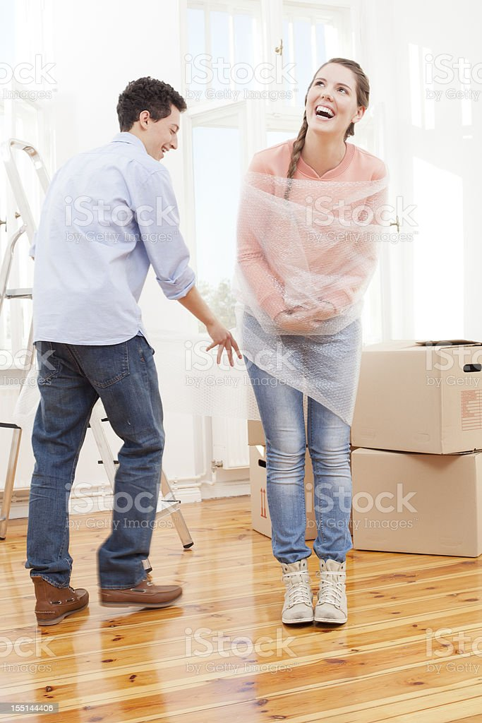 Couple moving house being playful royalty-free stock photo