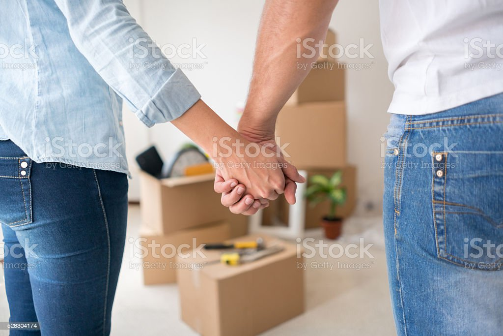 Couple moving to a new house stock photo