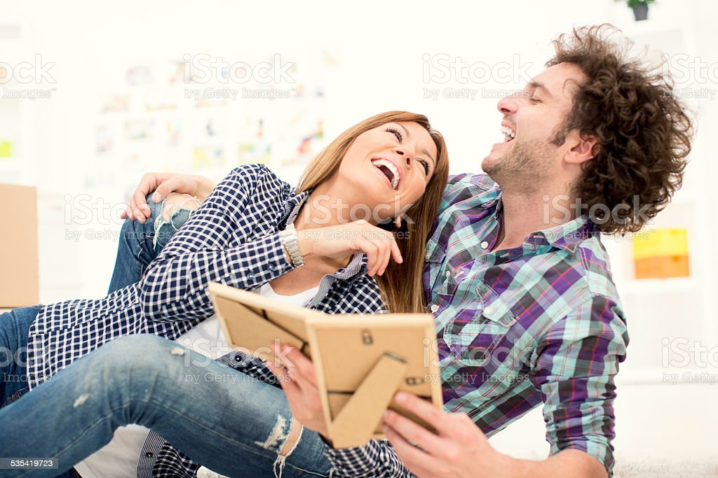 Couple moving to new apartment. stock photo