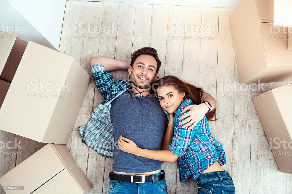 Couple moving to new home stock photo