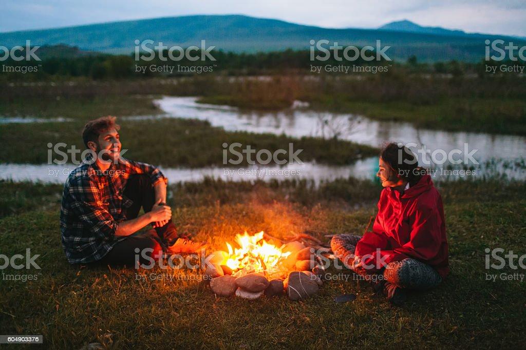 Couple near the campfire stock photo