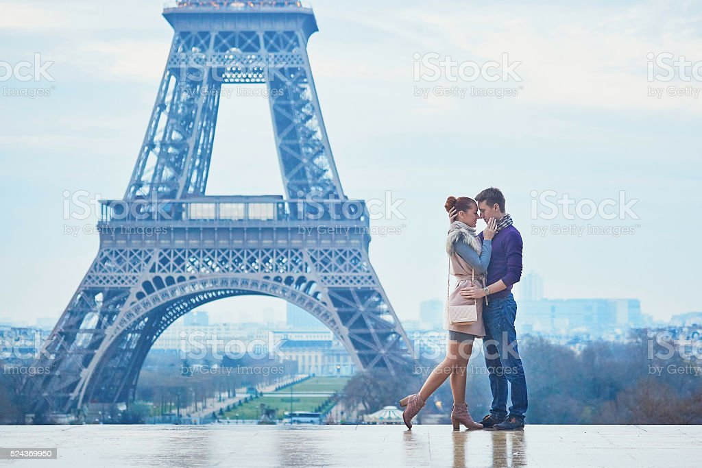 Couple near the Eiffel tower in Paris, France stock photo