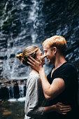 Couple near the waterfall