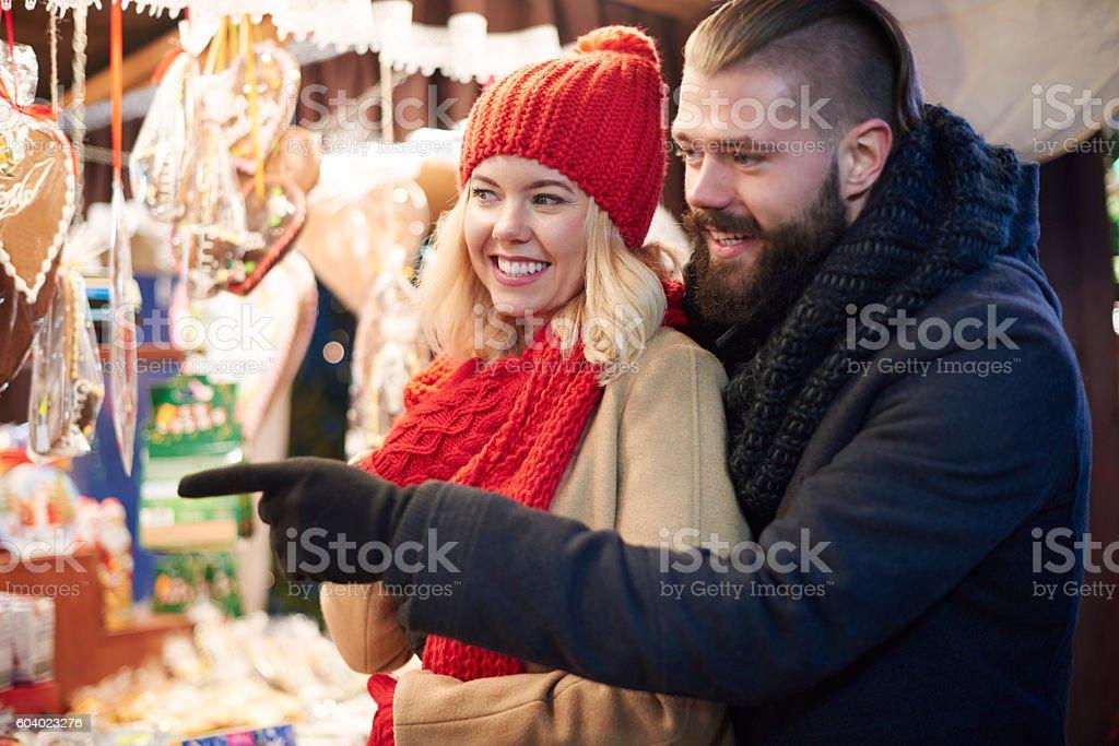 Couple next to the market stall stock photo