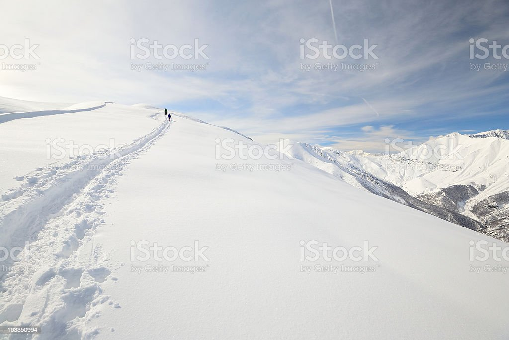 Couple of alpinist in winter royalty-free stock photo