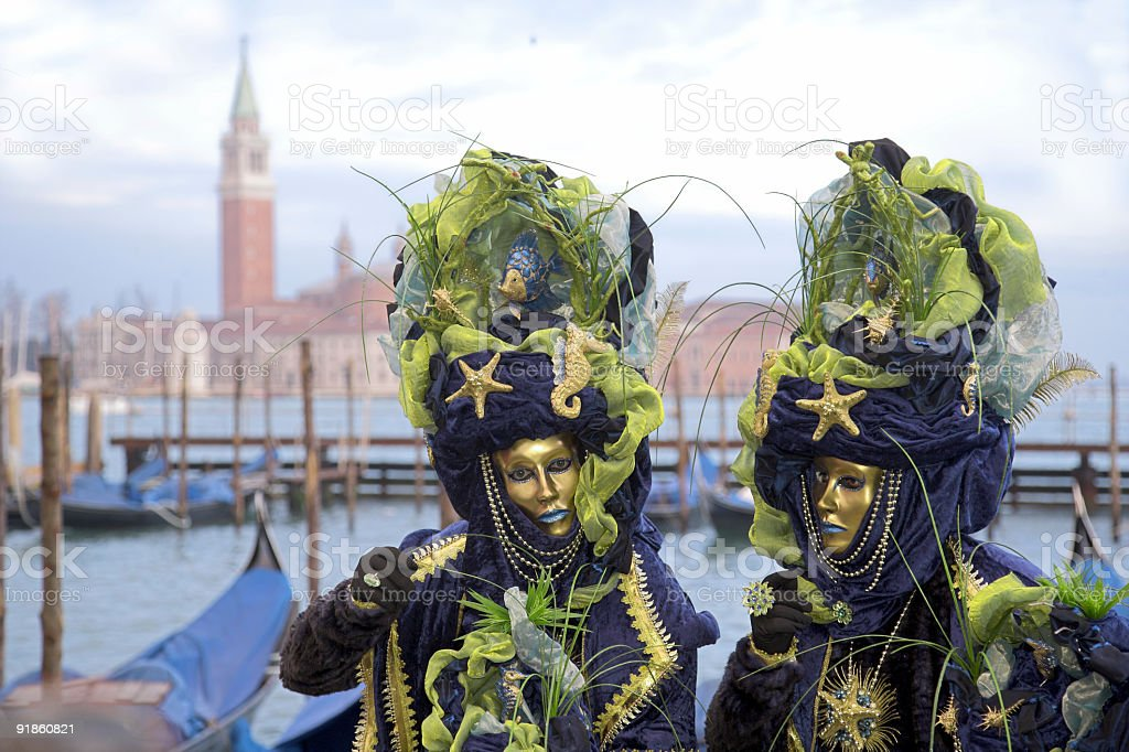 Couple of beautiful female masks at Grand Canal in Venice royalty-free stock photo