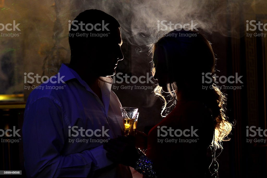 couple of beautiful young people drinking champagne stock photo