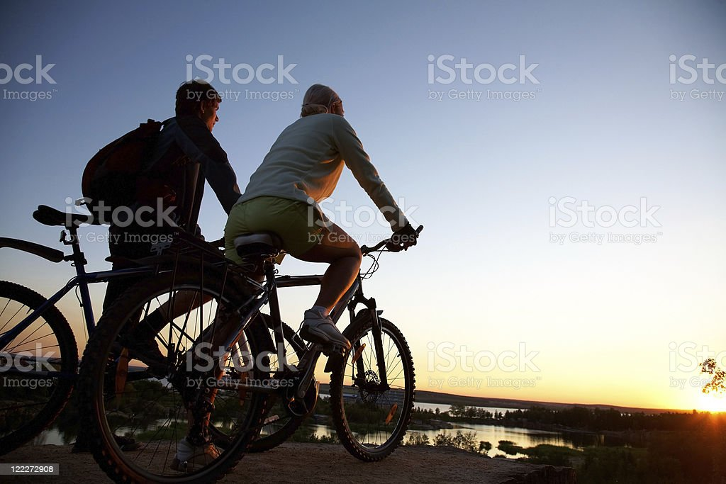 Couple of bicycles on sunset royalty-free stock photo