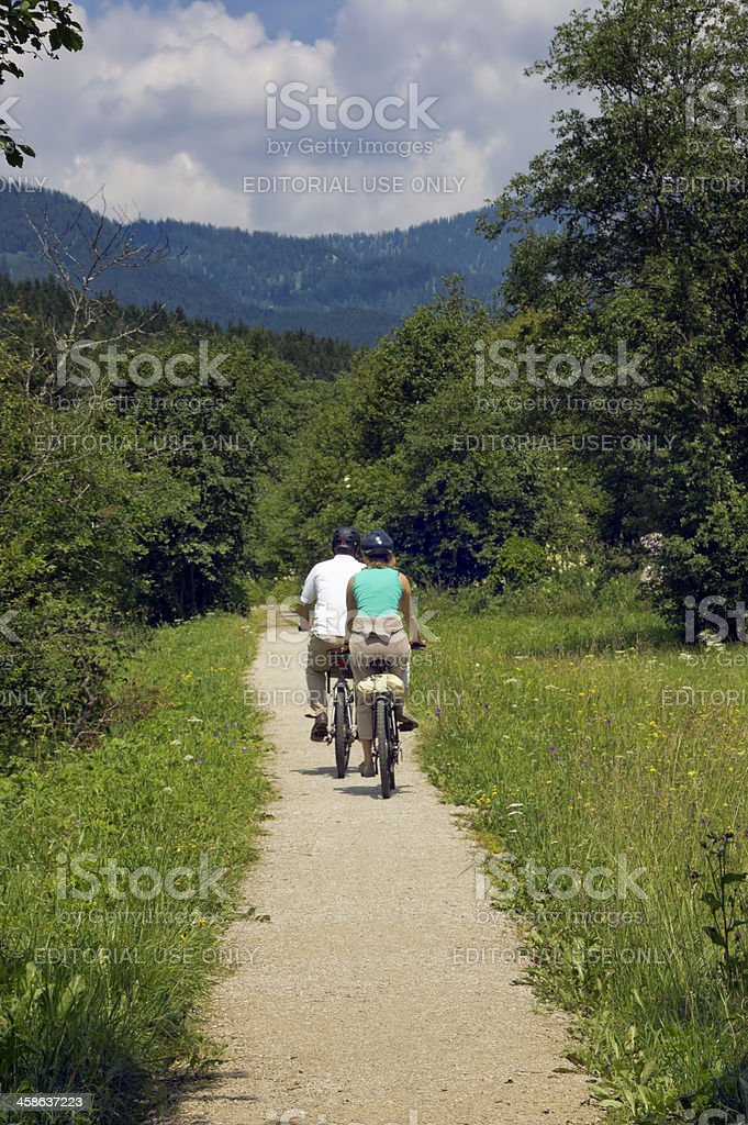 Couple of bikers along a mountain path royalty-free stock photo