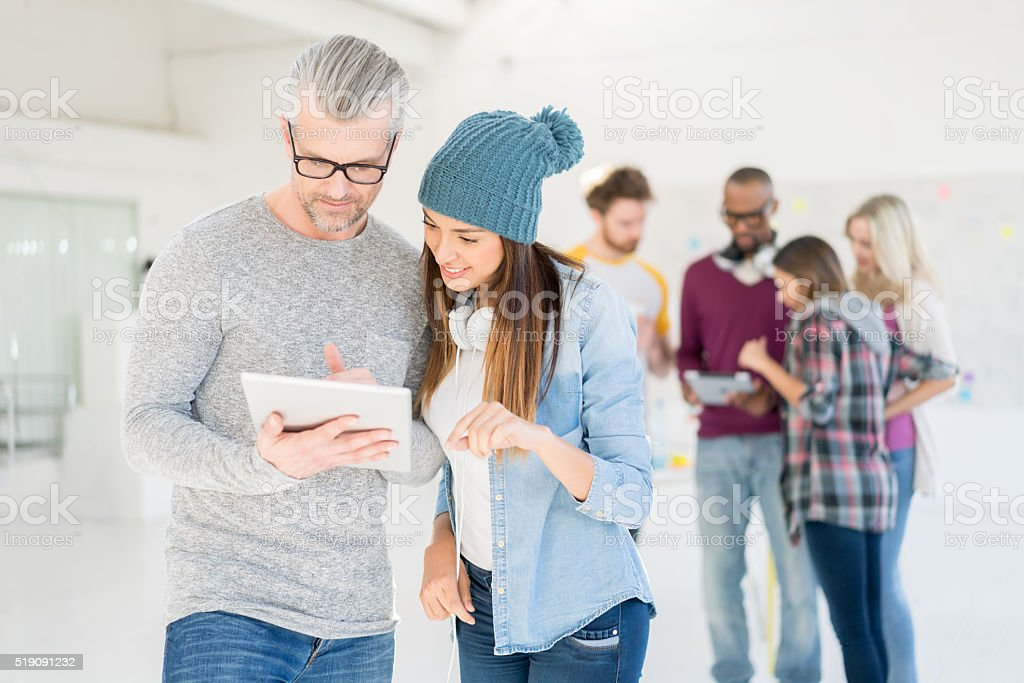 Couple of business people at a creative office stock photo