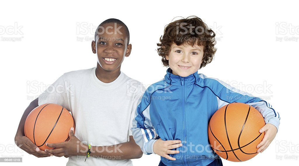 Couple of children with basketball stock photo