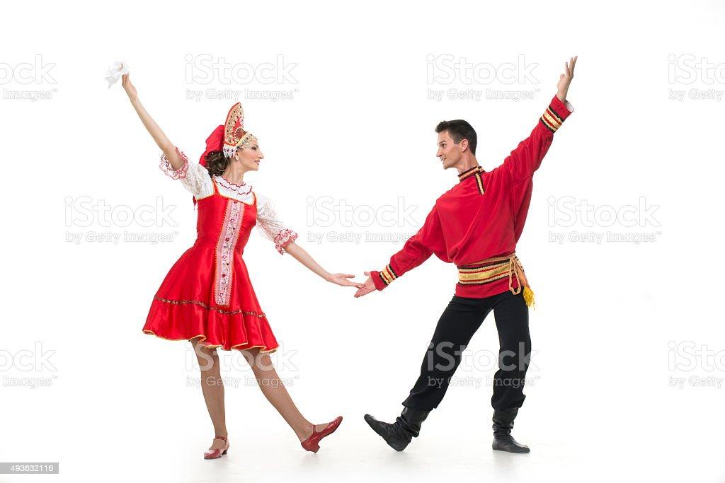 Couple of dancers in russian traditional costumes, sarafan, kokoshnik stock photo