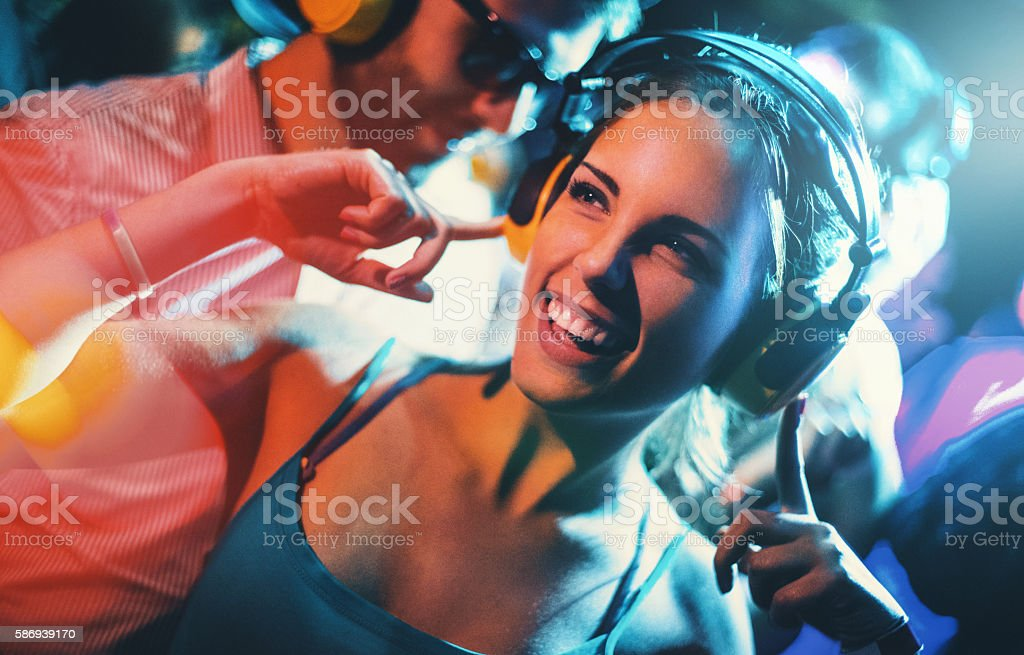 Couple of deejays at a party. stock photo