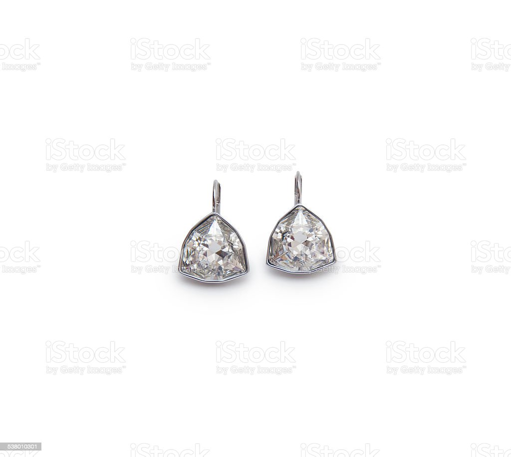 couple of diamond earrings stock photo