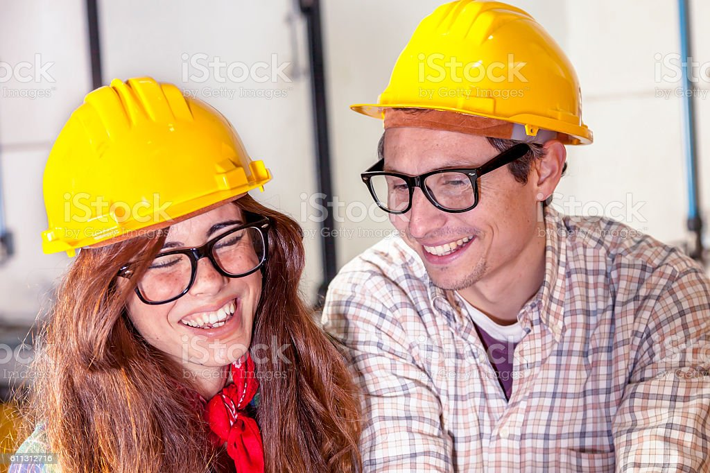 couple of engineers having fun consult the computer stock photo
