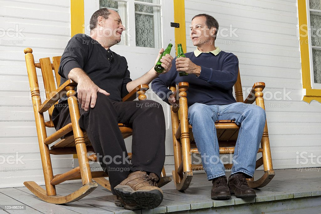 Couple of friends enjoying a beer stock photo