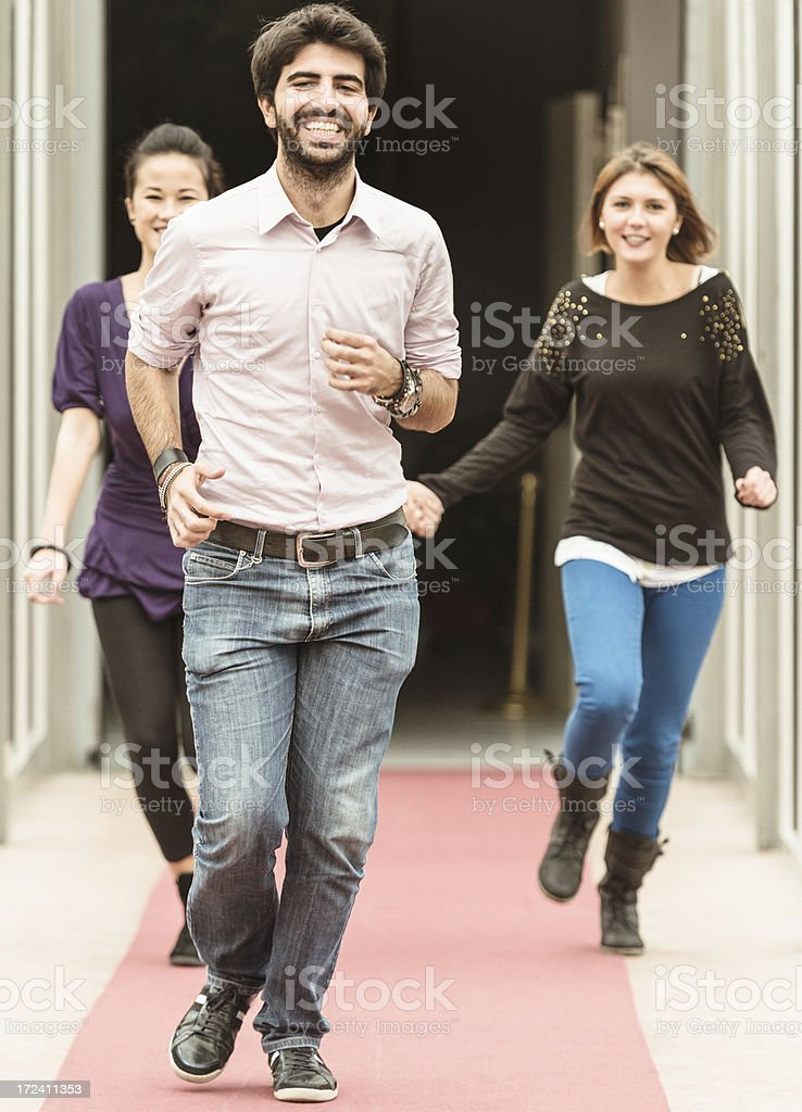Couple of friends running at the college royalty-free stock photo