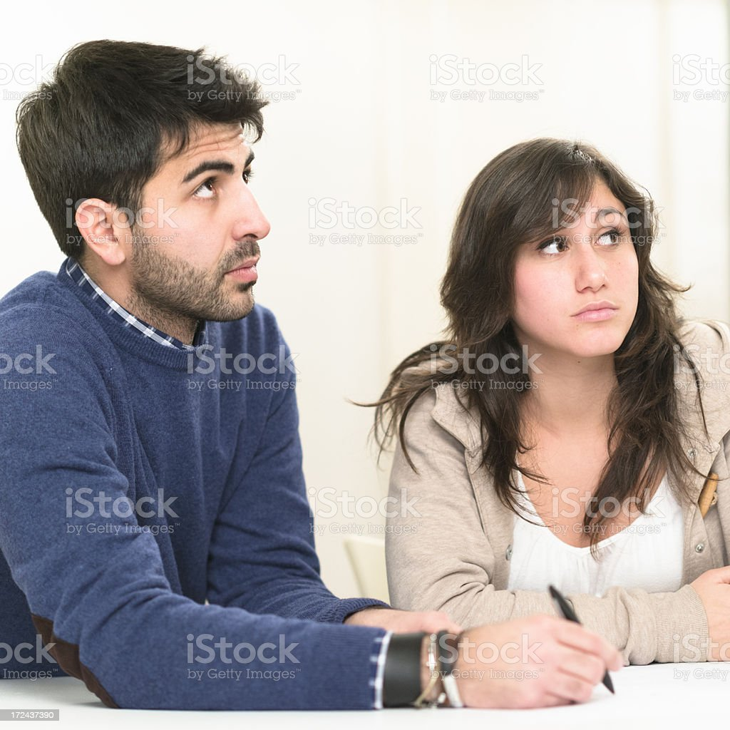 couple of friends studying and looking away royalty-free stock photo