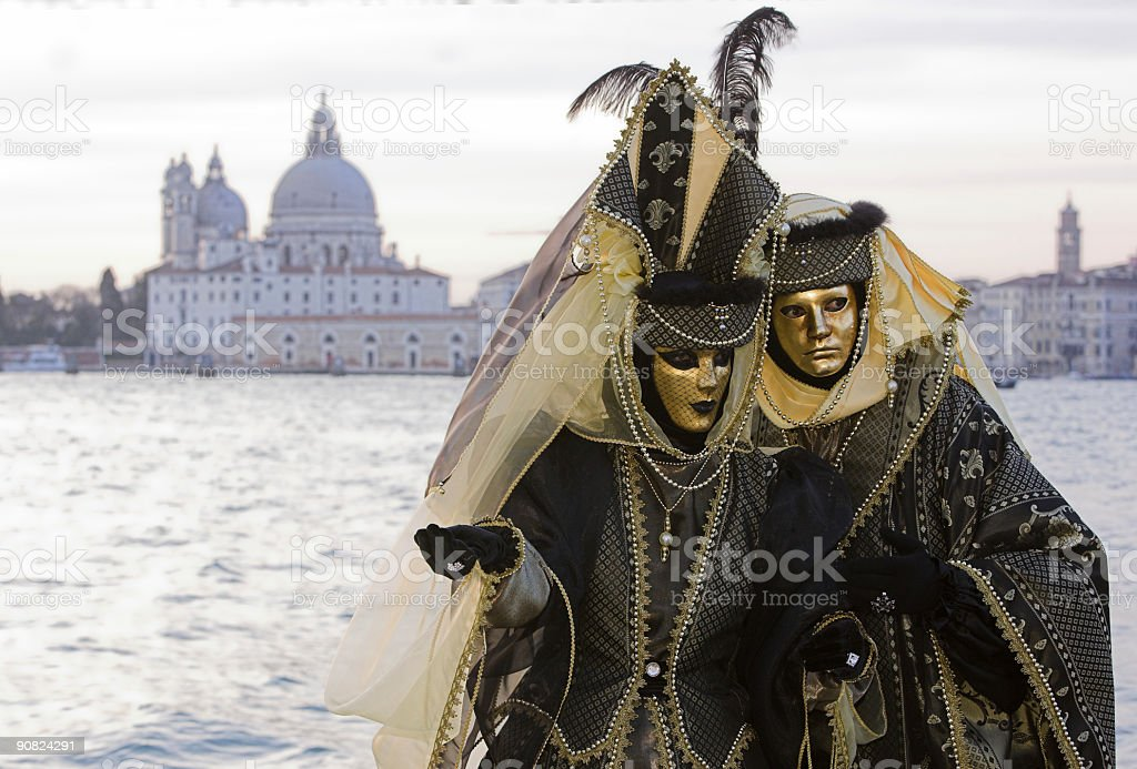 Couple of golden Venetian masks at Grand Canal (XL) royalty-free stock photo