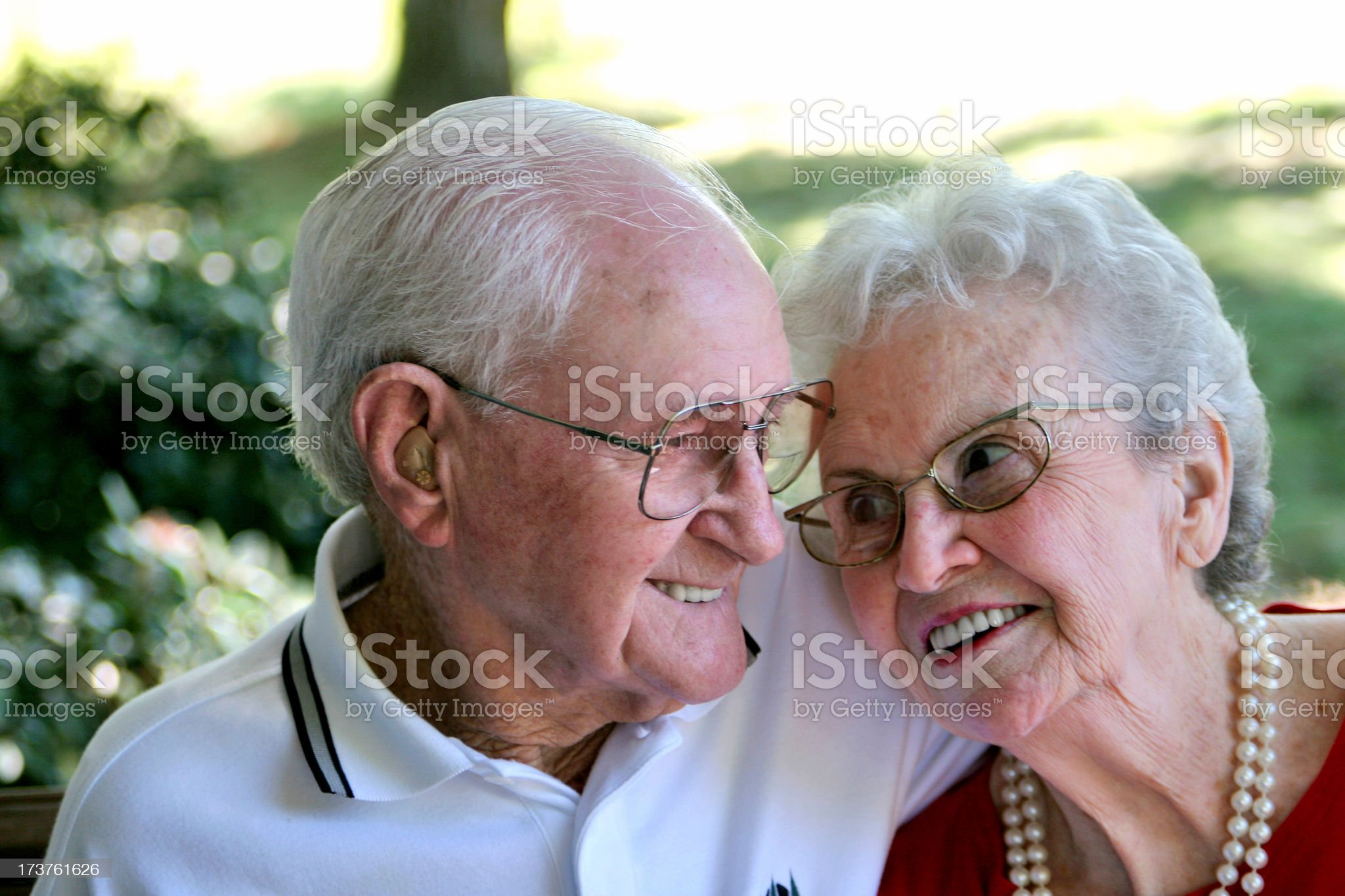 A couple of grandparents laughing together royalty-free stock photo