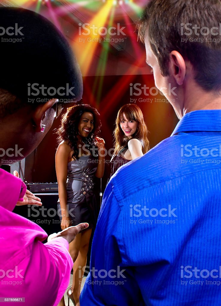 Couple of Guys Trying To Pickup Women at a Nightclub stock photo