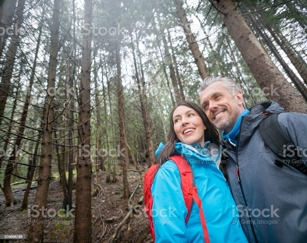 Couple of hikers looking very happy stock photo