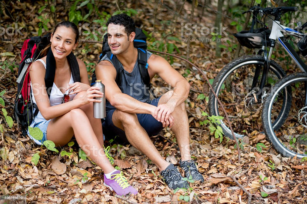 Couple of hikers taking a break stock photo