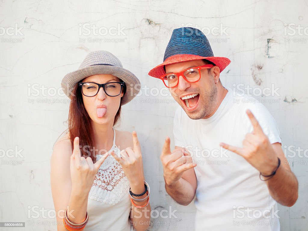 Couple of hipsters having fun stock photo
