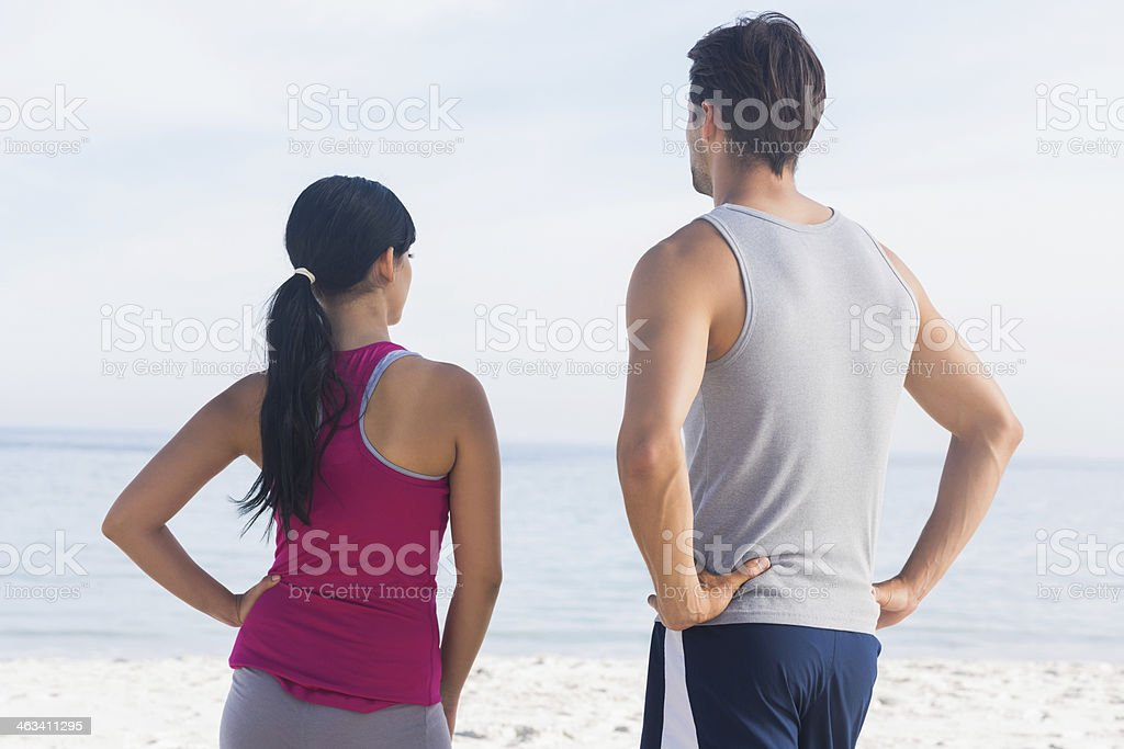 Couple of joggers looking at the sea royalty-free stock photo