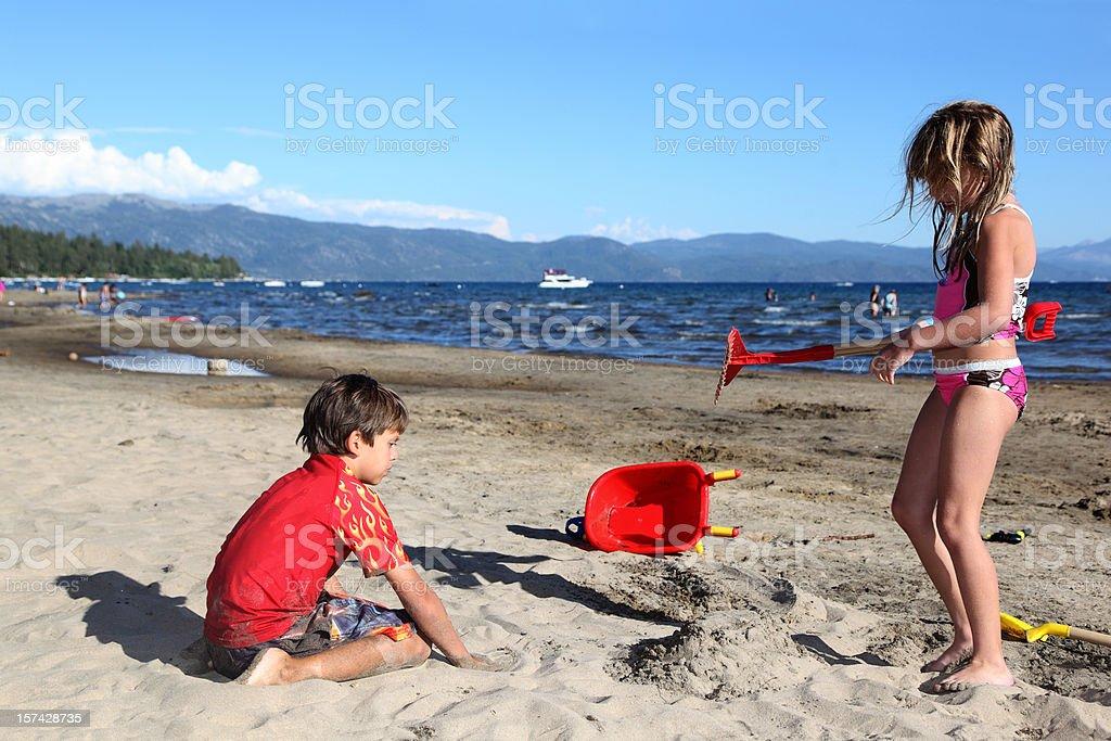Couple of Kids on the Beach stock photo