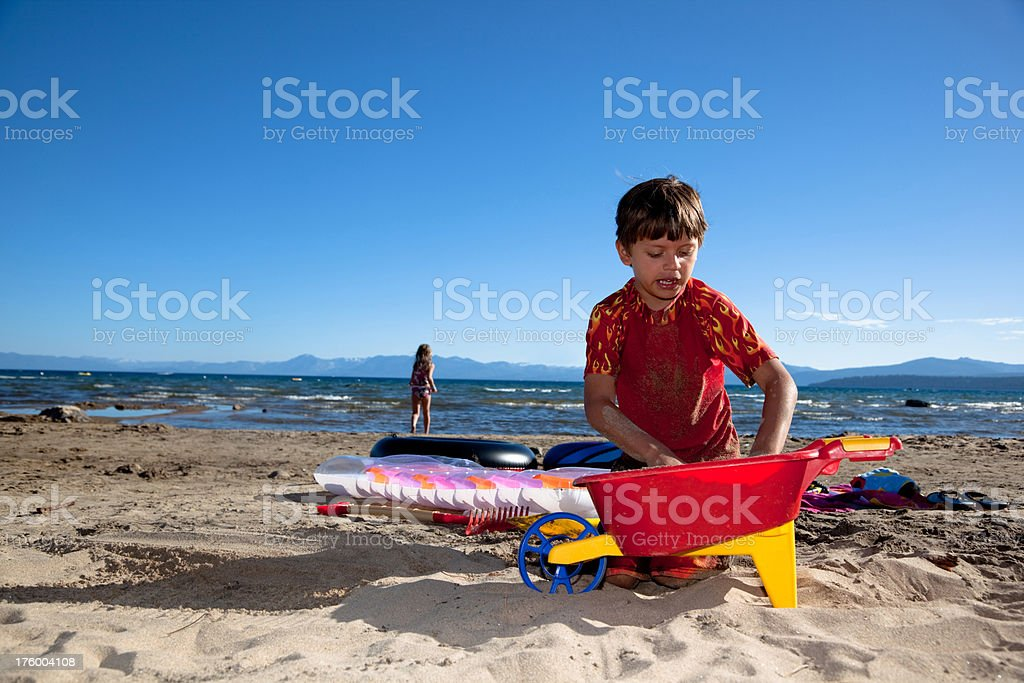 Couple of Kids Playing on the Beach stock photo