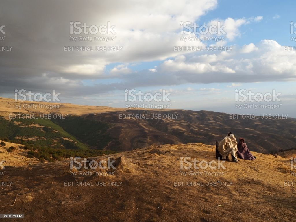A couple of local men sitting in the Simien Moutains stock photo