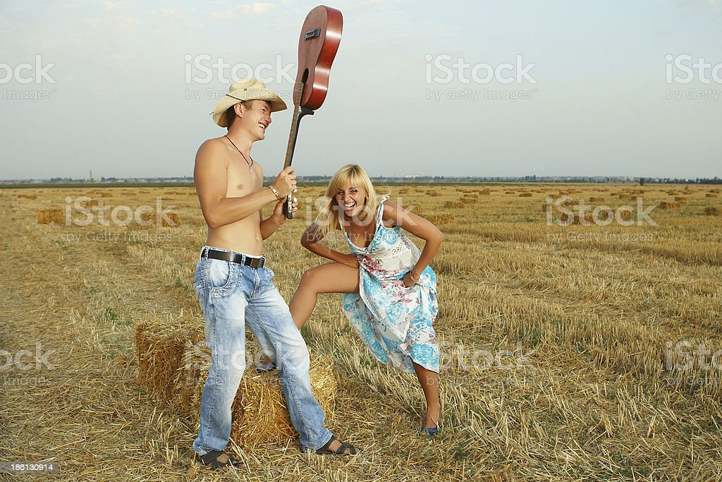 couple of lovers in the hay with guitar royalty-free stock photo