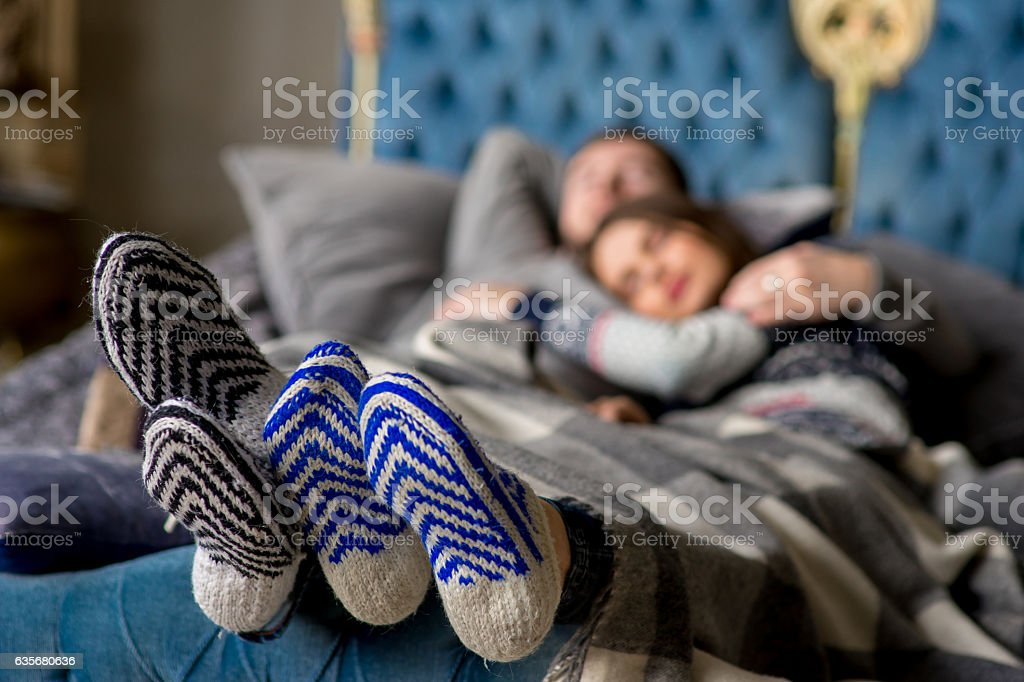 Couple of lovers lying on the sofa. Christmas time stock photo