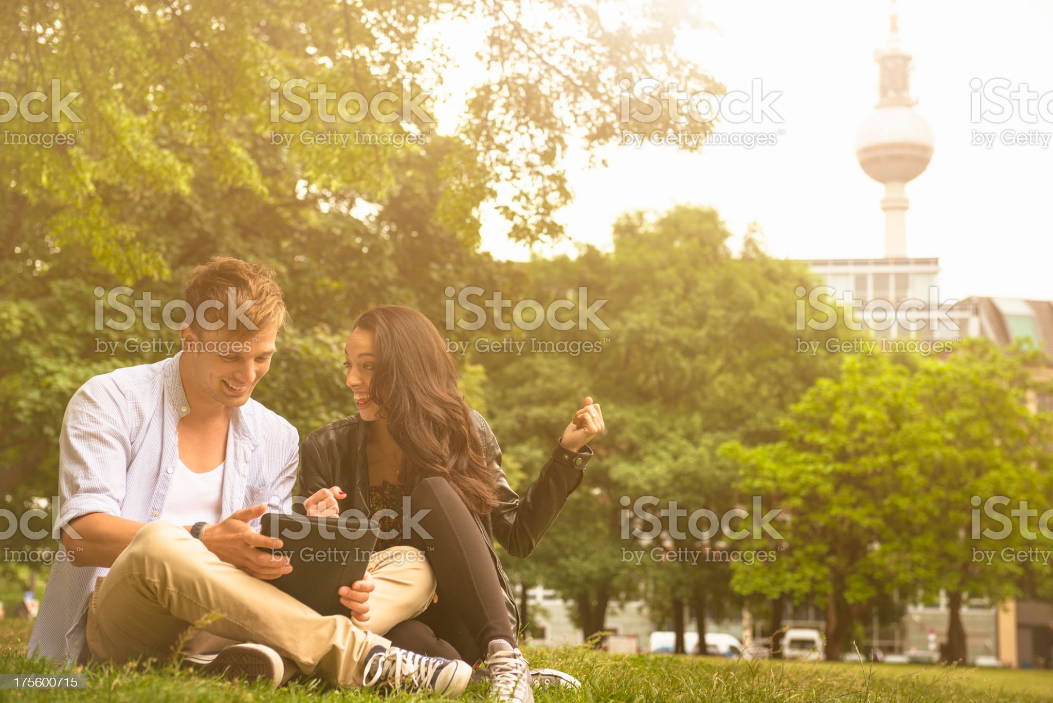 Couple of lovers surfing on social media app in Berlin royalty-free stock photo