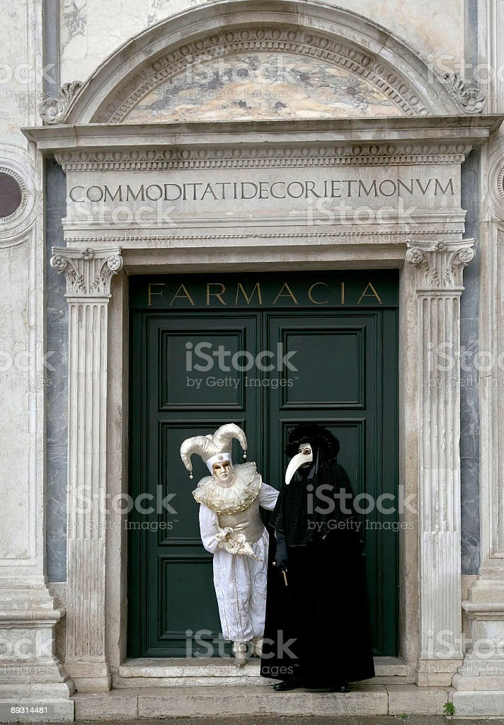 Couple of masks at historical drugstore in Venice royalty-free stock photo