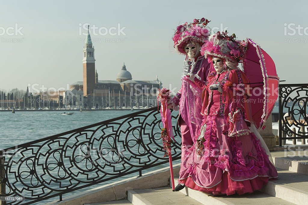Couple of masks on bridge at carnival in Venice (XXXL) royalty-free stock photo