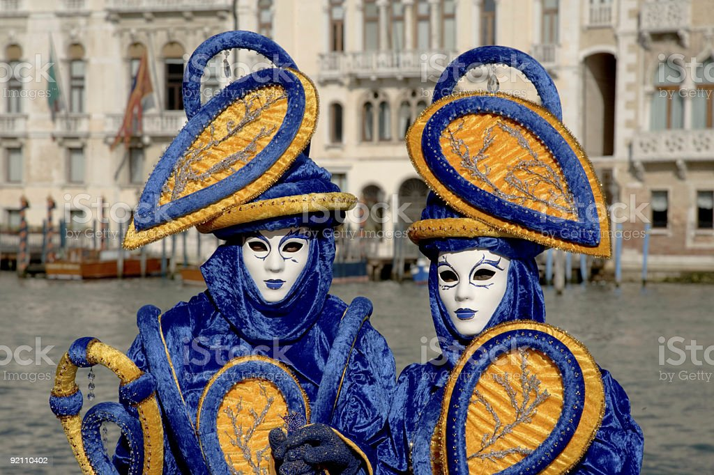 Couple of masks with colorful costumes in Venice (XXL) royalty-free stock photo
