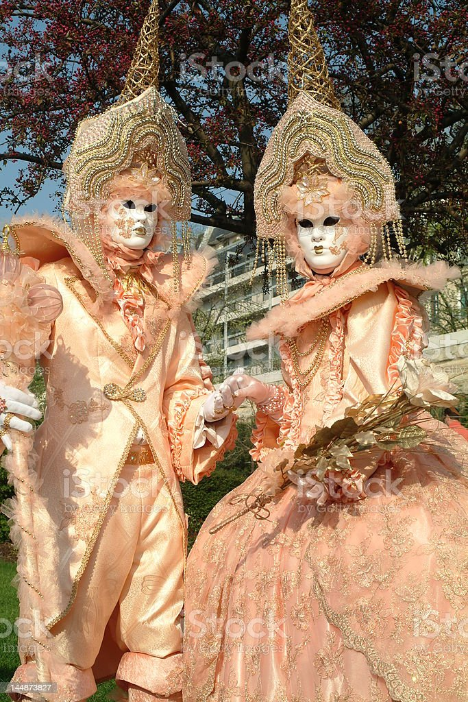 Couple of masqueraders stock photo